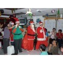 Santa Claus and Elf greet all children during Christmas Party
